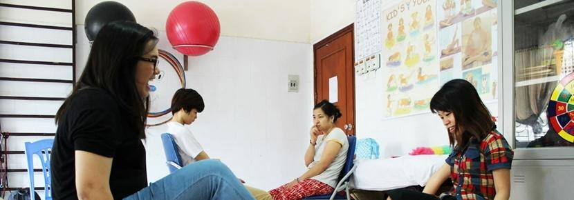 A Physiotherapy Elective student runs a therapy session for a person with special needs abroad.