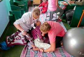 Student volunteers on their physiotherapy Student Elective help a young patient in Morocco.