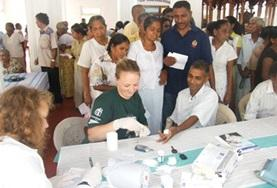 A volunteer intern on the Physiotherapy School Elective in Sri Lanka treats a child during her project.
