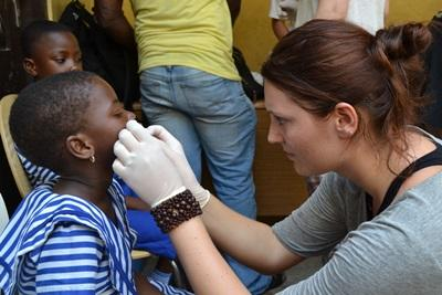 A Projects Abroad intern checks a child's teeth during an outreach in Ethiopia, Africa.