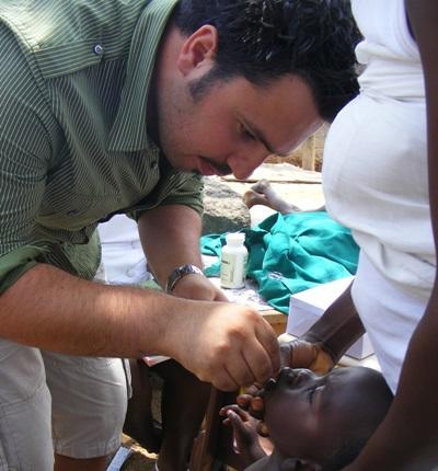 A Projects Abroad intern checks a child's teeth during a dental outreach in Ghana, West Africa.