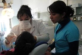 A dentistry volunteer observes a procedure at her placement in Argentina.