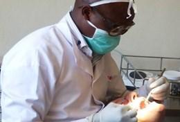 A volunteer on a Dentistry Internship in Kenya observes a local dentist's procedure.