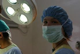 A dental intern in Nepal observes a dental procedure in the operating theatre.