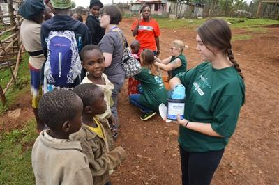Children in Kenya receive de-worming medication from a Projects Abroad medical intern in Africa.