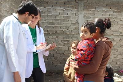 A Projects Abroad medical interns assists a local doctor with patients during an outreach in Mexico.
