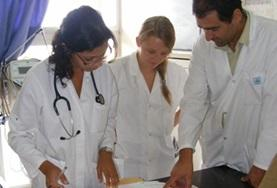 A doctor in Morocco explains a concept to his medical interns at their volunteer placement.