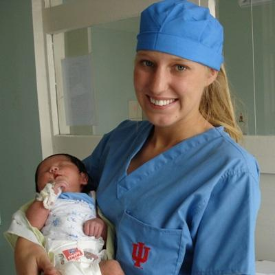 A Projects Abroad Midwifery intern holds a newborn baby in a hospital in Mongolia.