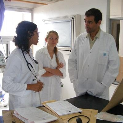 Midwifery interns discuss a medical case with a doctor at a hospital in Morocco.