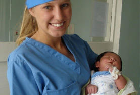 A Midwifery volunteer holds a baby at her internship placement in Mongolia.