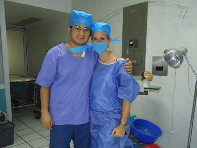 Two Projects Abroad medical interns put on scrubs to observe a surgical procedure in Mexico.