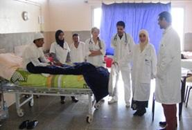 Nursing interns in Morocco observe senior nursing staff and doctors during consultations at their volunteer placement.