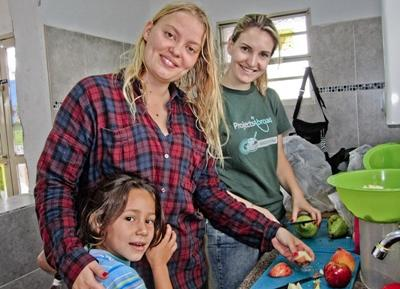 Projects Abroad interns prepare healthy fruit salads for children at their Nutrition Project in Bolivia.