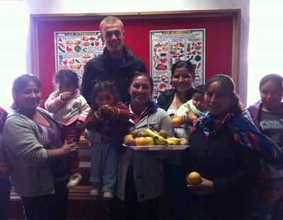 A Projects Abroad intern talks to mothers about good nutrition for their children in Peru.