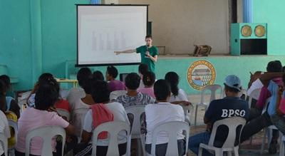 An Occupational Therapy intern in the Philippines gives a presentation to local therapists at a hospital.