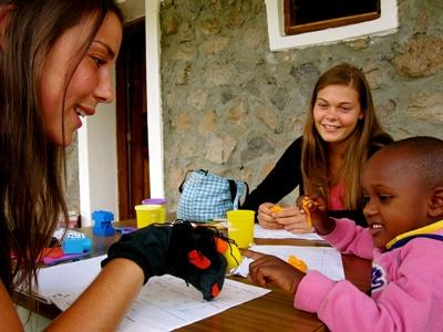 Occupational Therapy interns work with a young child at a schools in Tanzania.