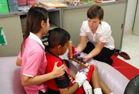 An Occupational Therapy intern works with a child in Phnom Penh, Cambodia, during her volunteer project.