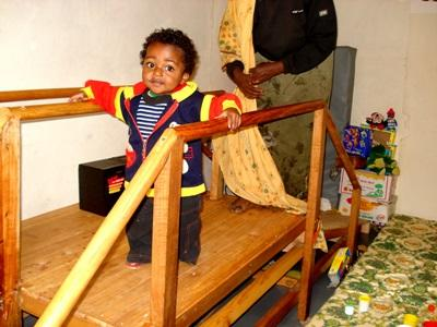 A child participates in physiotherapy exercises with a Projects Abroad intern in Ethiopia.