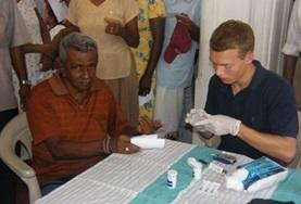 A volunteer works with a patient during his Physiotherapy Internship in Sri Lanka.
