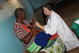 In Tanzania, a Physiotherapy Intern in Dar es Salaam helps a patient during a session of volunteer work.