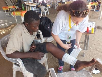 A man in Togo receives treatment from a Projects Abroad Public Health intern.