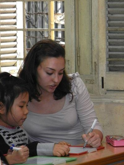 A Projects Abroad Speech Therapy intern works with a child at a special needs school in Vietnam.