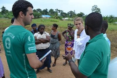 Projects Abroad Microfinance interns discuss business plans with entrepeneurs in Ghana.
