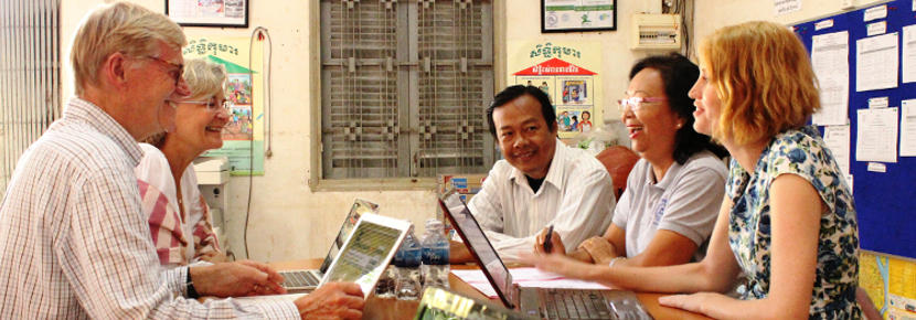 A group of Projects Abroad Microfinance interns discuss ways to assist entrepeneurs in Cambodia.