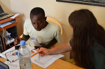 Local entrepreneur asks Microfinance intern for advice at the Projects Abroad office in Senegal.