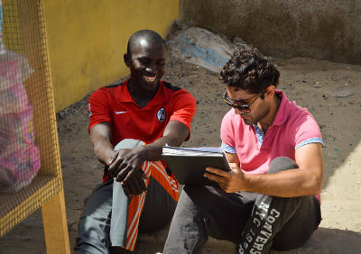 A Projects Abroad Microfinance intern works with a local entrepeneur  in St Louis, Senegal.