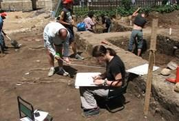 Professional volunteer archaeologists work abroad at a digging site in Romania.