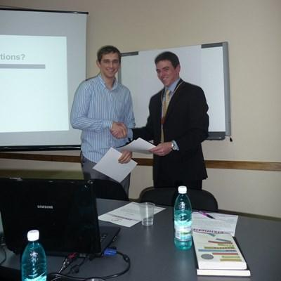 Professional consultants volunteering in Romania give a presentation for a local company.