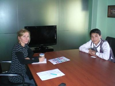 A professional economist volunteering in Mongolia has a meeting with a local economist.