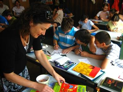 An art therpist volunteering in Romania works with local school children who have developmental problems.