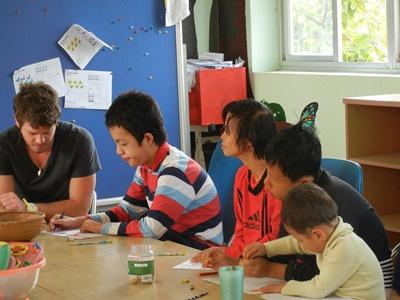 A psychologist works with special needs children at a clinic in Vietnam.