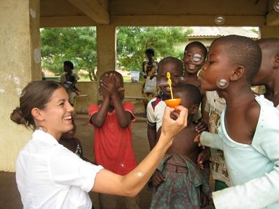 Professional social worker playing with children at placement in Ghana