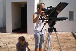 In Jamaica, a professional journalist films a segment as part of her volunteering journalism trip.