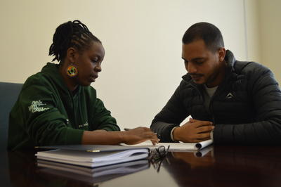 Volunteers work alongside attorney and project manager of our Human Rights Project, Maria Mulindi