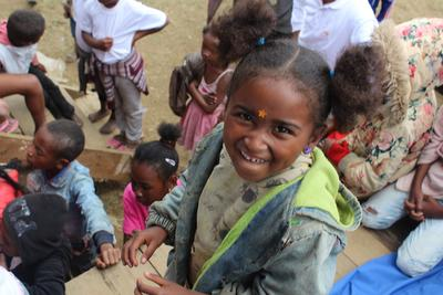 A child in Madagascar attends a medical outreach where she is treated by a volunteer doctor.