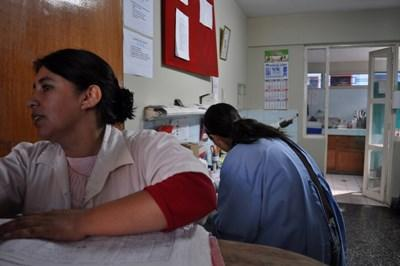 A nurse volunteering in Peru takes a break at the hospital with other local nurses.
