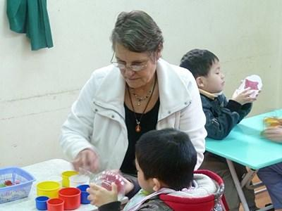 An occupational therapist uses her experience to help children as a volunteer in Vietnam.