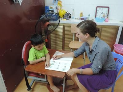 A child receives treatment from a professional occupational therapist in Vietnam.