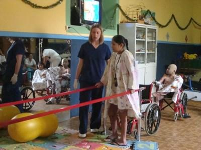 Professional occupational therapy volunteer guiding patient in Bolivia