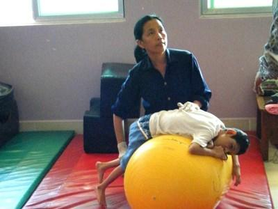 Professional volunteer with patient on professional physiotherapy project in Cambodia
