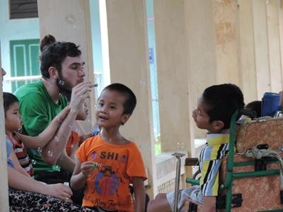 A volunteer works with disabled children at a Speech Therapy project in Vietnam.