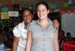 The Midwifery PRO volunteer with a baby she helped deliver in Jamaica.