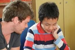 A professional speech therapy volunteer works with children at a rehabilitation centre in Vietnam.
