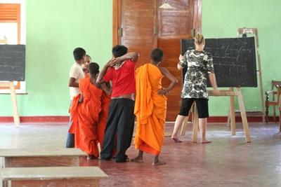 Young children attend a class taught by a professional teacher volunteering in Sri Lanka.