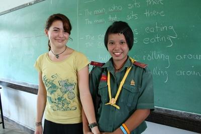 A teacher spends time with local students during her time volunteering in Thailand.