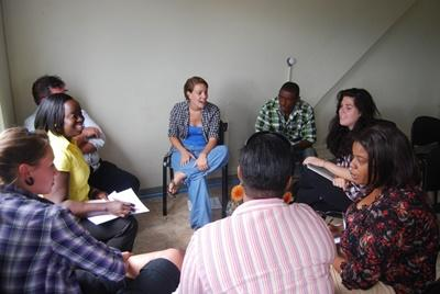 A professional teacher teaches a community literacy class to adults in Jamaica.
